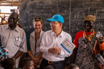 Secretary-General Ban Ki-moon (centre) visits Protection of Civilians Site 3 (PoC 3), adjacent to UN House, where he met with children from Hope Primary School. 25 February 2016 Juba, South Sudan. UN Photo/JC McIlwaine