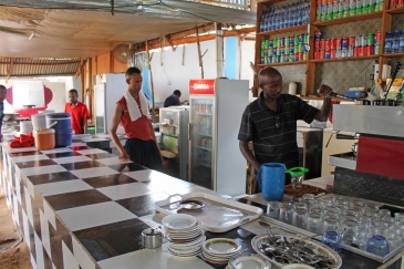 Somalis prepare coffee for customers in a  Mogadishu  restaurant. Photo: AP Photo/Farah Abdi Warsameh