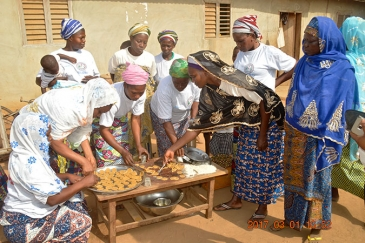 Women in the Lougba group, Benin, making soy biscuits. Photo: ANAF Benin