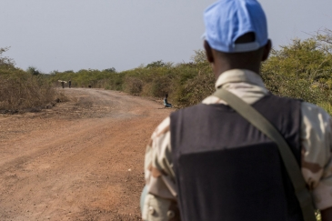 In this file photograph, an UNMISS peacekeeper patrols a road near Bentiu, Unity state, South Sudan. Patrols such as these serve to show a presence and to provide protection in the area. Photo: UNMISS