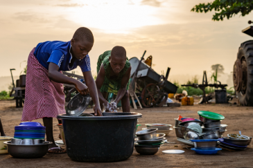 Girls washing dishes in Lome, Togo.