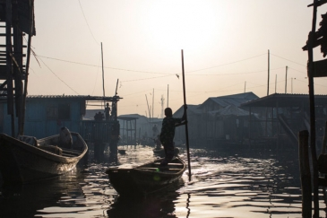 In Lagos, Nigeria, residents navigate the polluted waters of Makoko, a fishing community mostly made up of structures on stilts above Lagos Lagoon, as smog spreads throughout the canals.
