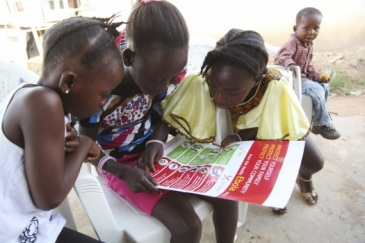 Girls in Voinjama, Liberia, look at a poster that displays information on Ebola.   Photo: UNICEF/Liberia/Jallanzo