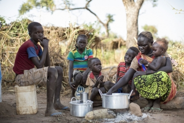 Sudanese refugee Amal Bakith cooks the first breakfast for her children a day after arriving in Ajuong Thok camp, South Sudan. During their long journey from South Kordofan, they had only rotten food to eat. Photo: UNHCR/Rocco Nuri