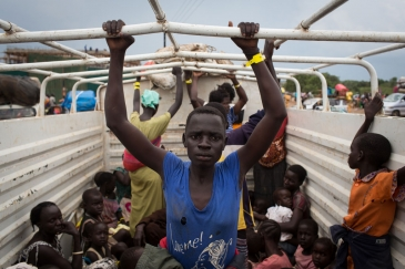 Refugees from South Sudan are transported from Elego town to the Numanzi Transit Center where meals and temporary accommodation are provided by UNHCR in Adjumani, northern Uganda. Photo: UNHCR/Will Swanson