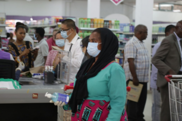 Tanzanians shopping at a supermarket in Dar-es- Salam