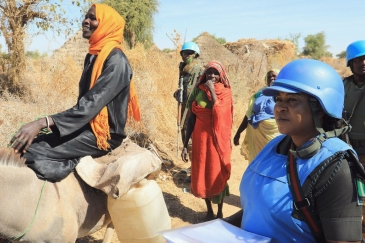 UNAMID peacekeepers provide protection to local women in Aurokuom village farming area south Zalingei, Central Darfur.