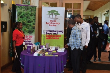Guests view publications at the opening of the African Plant Breeding Academy in Nairobi, Kenya. Photo: ICRAF/Thellesi Media