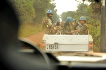 MONUSCO troops providing an armed escort. Photo: Guy Oliver/IRIN