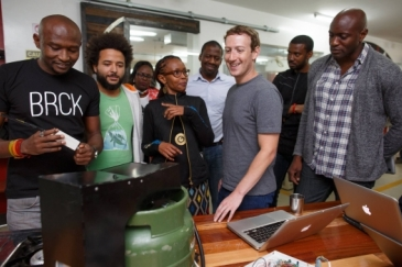 Facebook CEO Mark Zuckerberg (in grey T-shirt) meeting with entrepreneurs and developers in Nairobi, Kenya.     Facebook/Mark Zuckerberg