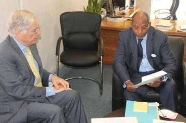 Dr Mayaki with Brazil's Ambassador to SA Mr. P L Carneiro De Mendonça handing over NEPAD's Agriculture in Africa Outlook