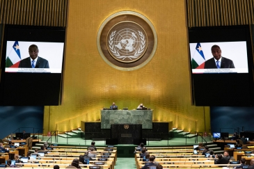 Faustin Archange Touadera (on screen) of the Central African Republic addresses the general ...