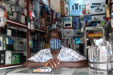A trader in his electronics shop in the market in Treichville, Abidjan, during the COVID-19 crisis.