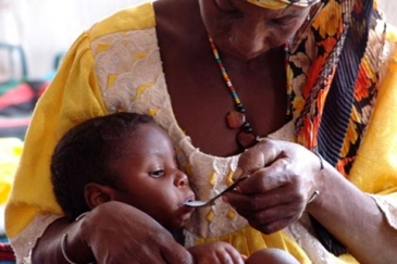 Mother feeds her child in Niger
