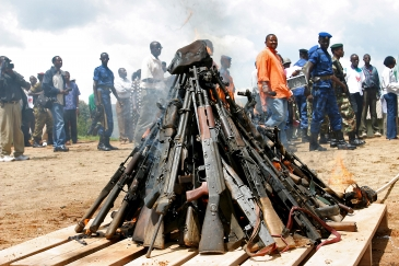 Weapons being burnt during the official launch of the Disarmament, Demobilization, Rehabilitation and Reintegration (DDRR) process in Muramvya, Burundi.             UN Photo/Martine Perret