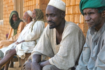 In south Darfur, Sudan, Ambororo nomadic tribesmen wait for transport to the Blue Nile State. (file)