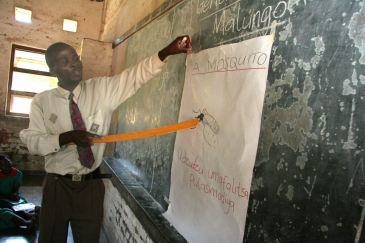 In Malawi, children learn about malaria and mosquitoes in school classes. A teacher explains about mosquitoes and malaria. Photo: WHO