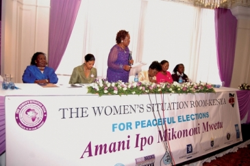 Women leaders and representatives of Kenya's electoral body, the police and the UN sit at the Women's Situation Room in Nairobi, Kenya that used diplomacy to help reduce  electoral violence during Kenya's last general elections. Photo:Joseph Mathenge