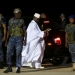 The Gambia's former president Yahya Jammeh (in white) prepares to depart from Banjul airport to exile in Guinea Bissau on January 21, 2017. Photo: Reuters/Thierry Gouegnon