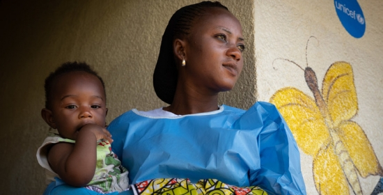 An Ebola survivor cares for her six-month-old son at a UNICEF-supported crèche in Beni, eastern DR Congo, December 2018. Photo: © UNICEF/UN0264160/Hubbard