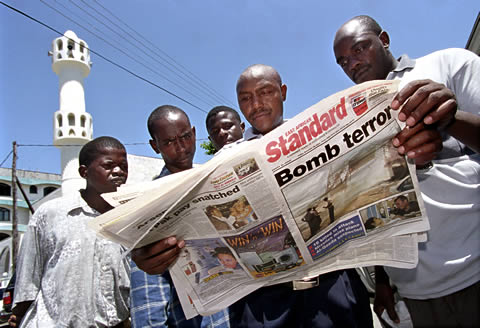 A day after bombings in Mombasa, Kenya, in 2002, against Israeli-linked targets, residents outside one of the city's mosques read a newspaper for details of the attack, which was claimed by Al-Qaida.