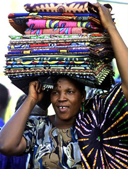 A market trader in Bamako, Mali, selling African-made textiles