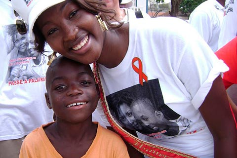 Miss Angola with a child during an AIDS solidarity event in Angola.