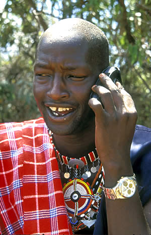 Young Kenyan using mobile phone.