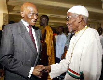 President Abdoulaye Wade (left) with Father Augustin Diamacoune Senghor, political leader of the Casamance rebels