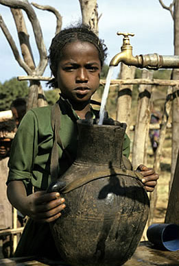 Girl at communal village water tap in Ethiopia