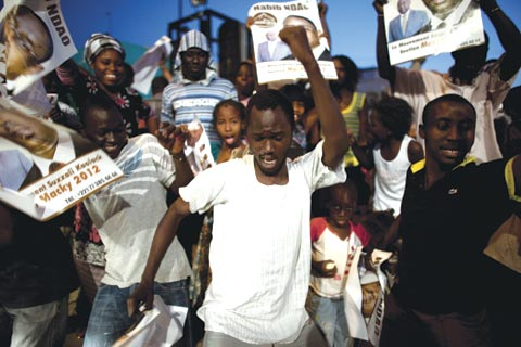 Residents of Dakar celebrate the election of a new president