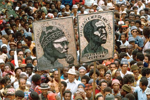 A rally in Cape Verde with portraits of Amilcar Cabral and Aristides Pereira