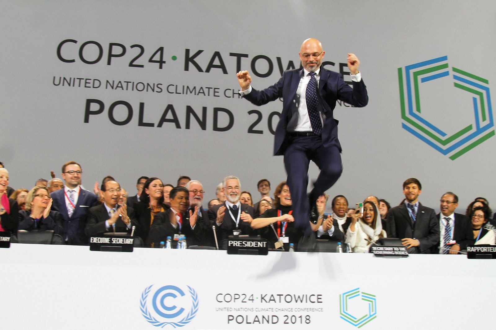 COP24 President Michael Kurtyka, State Secretary, Ministry of Energy, Poland, jumps after approval of the Paris Agreement Work Programme at 2018 Katowice conference.