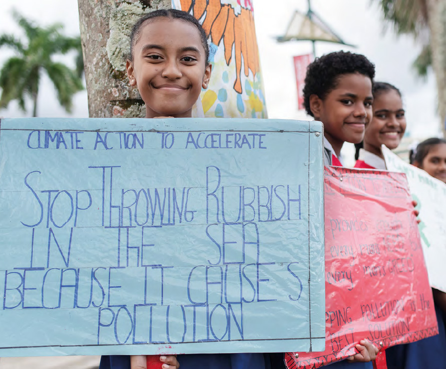 Students with climate action signs in Albert park, Suva, Fiji
