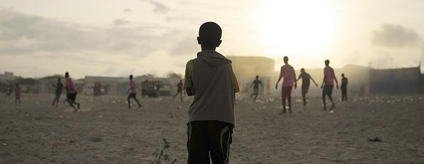 Boys Play Football Near IDP Camp in Mogadishu. Photo: UN Photo/ Tobin Jones