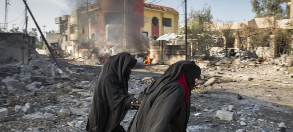 Family climbs out destroyed home after an ISIL bomb