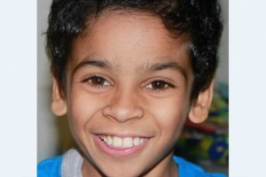 A boy with autism smiling