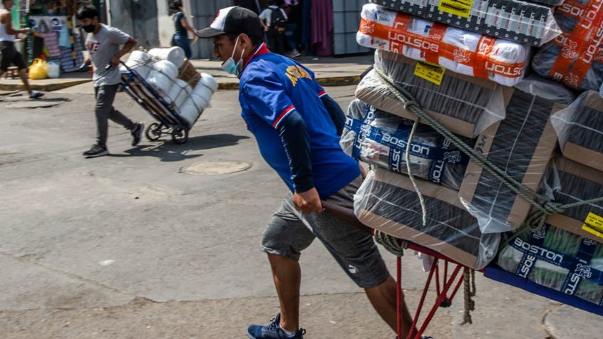 IMF/Ernesto Benavides Goods are transported by hands in Lima, Peru.