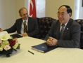 Permanent Representative of Turkey to the United Nations Ambassador Yasar Halit Çevik and DESA's Under-Secretary-General Wu Hongbo at the signing of the host country agreement between the United Nations and Turkey