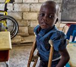 A student poses in the classroom. 38 year old Ronald Joseph lost both his legs in a motorcycle accident in 1997. On march 11, 2011 with the help of the non government organization Help for Haiti, Joseph transformed his personal loss into a communal gain by opening a school for handicapped children in the poor and often volatile Cite Soleil. Currently the one room school helps 50 children from the neighborhood but expansion plans are already underway. Photo Logan Abassi UN/MINUSTAH