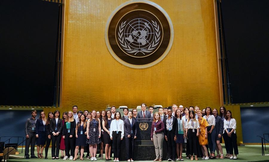 Summer interns taking a photo with DGACM USG Movses Abelian in the General Assembly Hall. UNHQ/DGACM