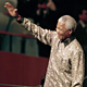 Nelson Rolihlahla Mandela (left), President of South Africa, enters General Assembly Hall to address its fifty-third session. He is flanked by United Nations Chief of Protocol, Nadia Younes.