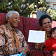 Mr. Mandela and Ms. Graça Machel with children during a Nelson Mandela Children's Fund event, August 2007.