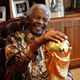 Mr. Mandela holds the FIFA World Cup before the start of the 2010 tournament in South Africa.