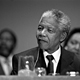 "Nelson Mandela, President of the African National Congress, addresses a press conference where he called for a ""phased maintenance"" of sanctions."