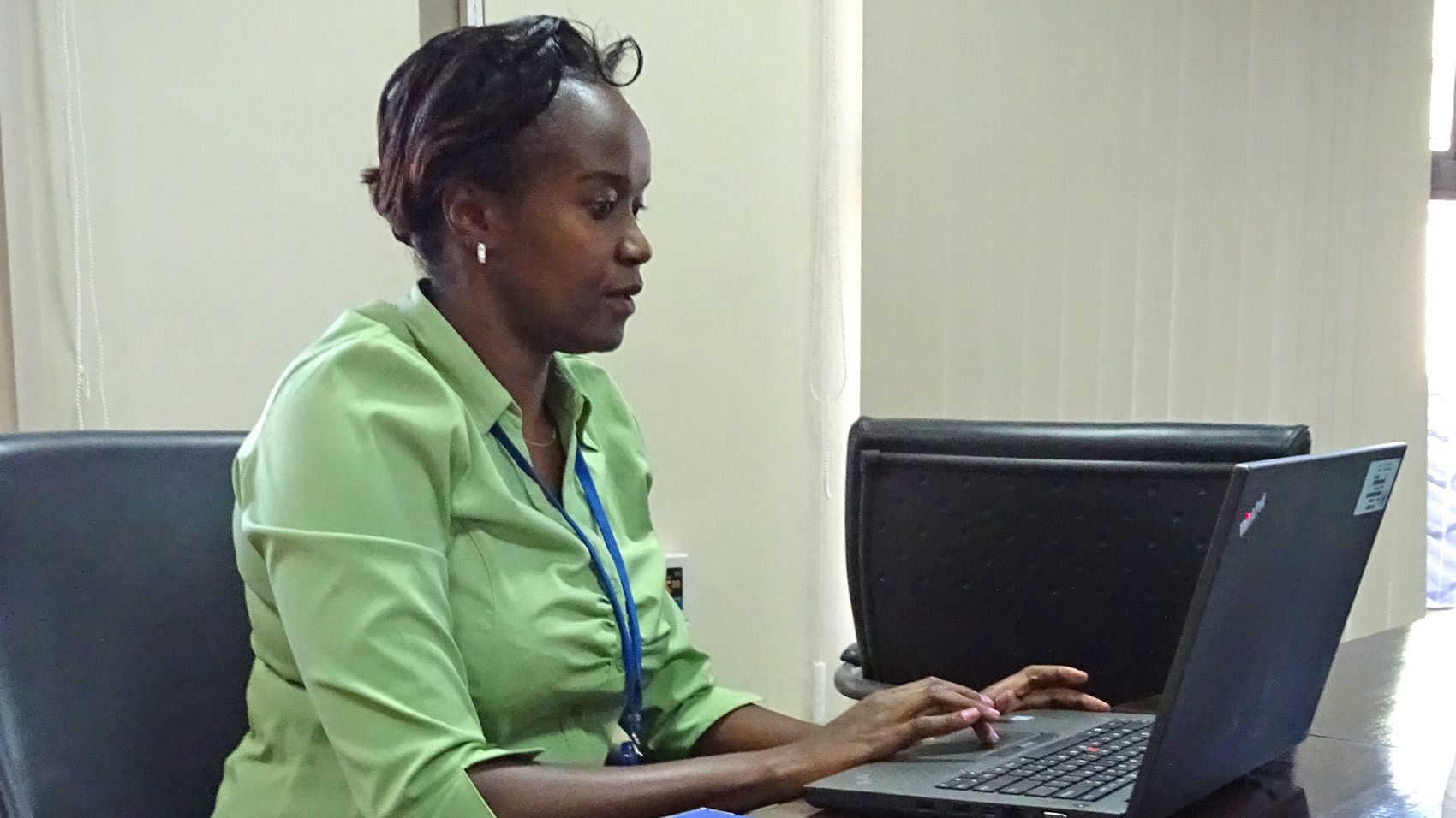 Photo of Legal Officer Evelyn Kamau working in the courtroom in Nairobi.