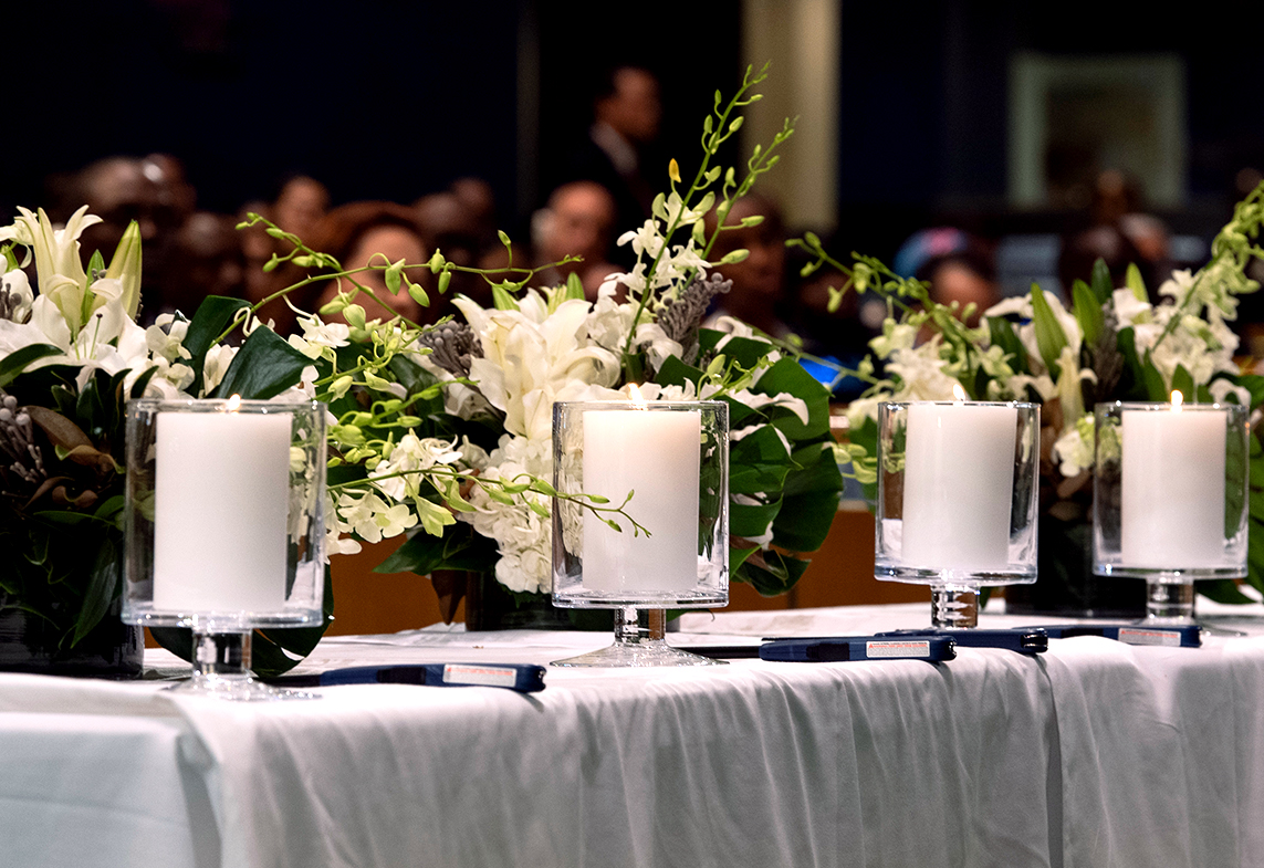 Photo of candles and wreaths on a table.