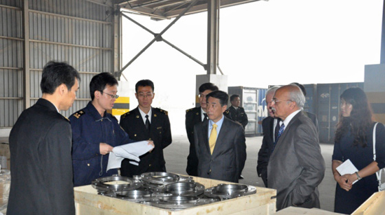At Tianjin port, photo of Chinese Customs Officers explaining their procedures for examining cargo to Ambassador Oh Joon (centre), Chair of the 1540 Committee, during the Committee's visit to China on 23 and 24 October 2014.