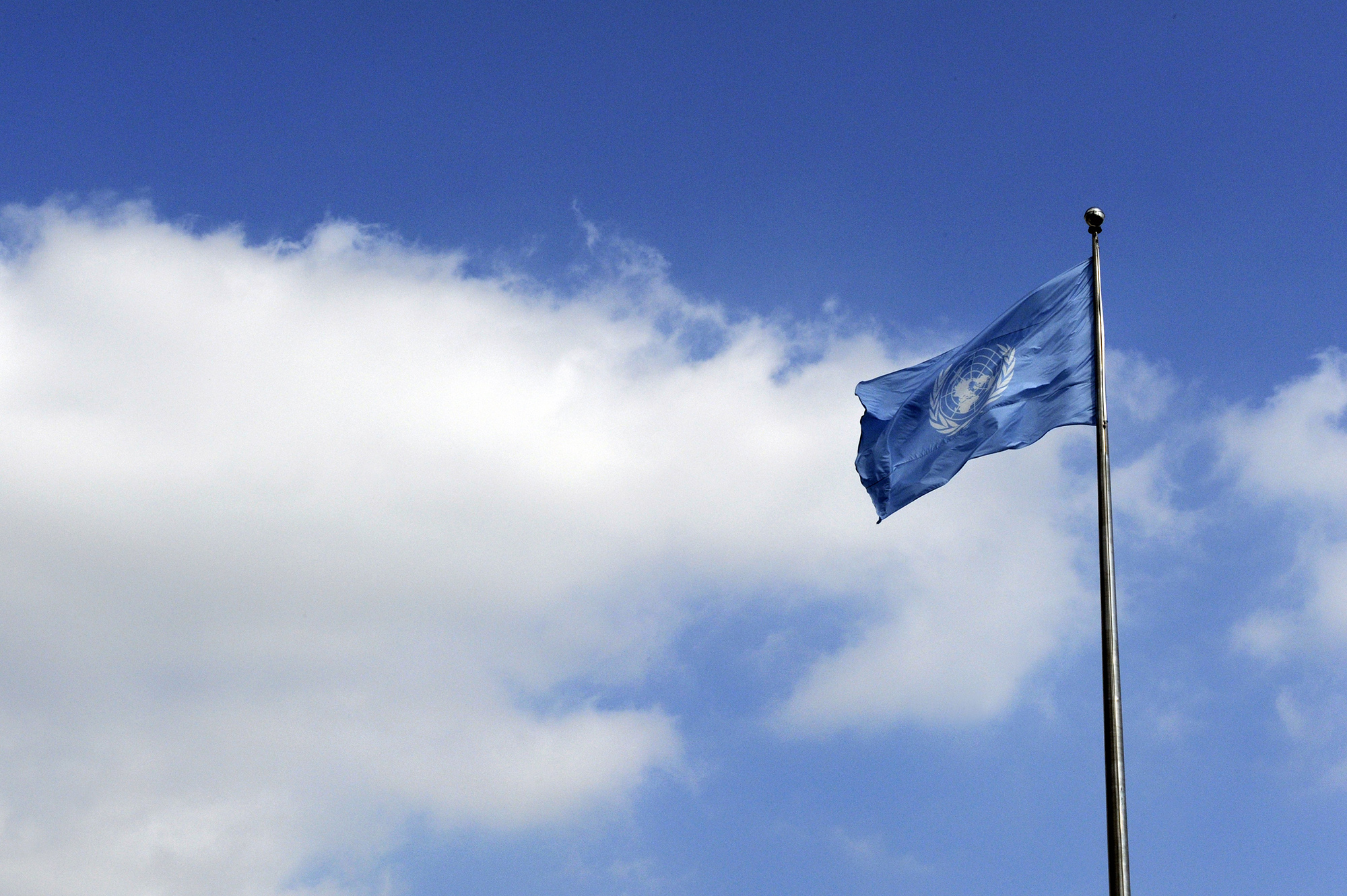 United Nations waving flag
