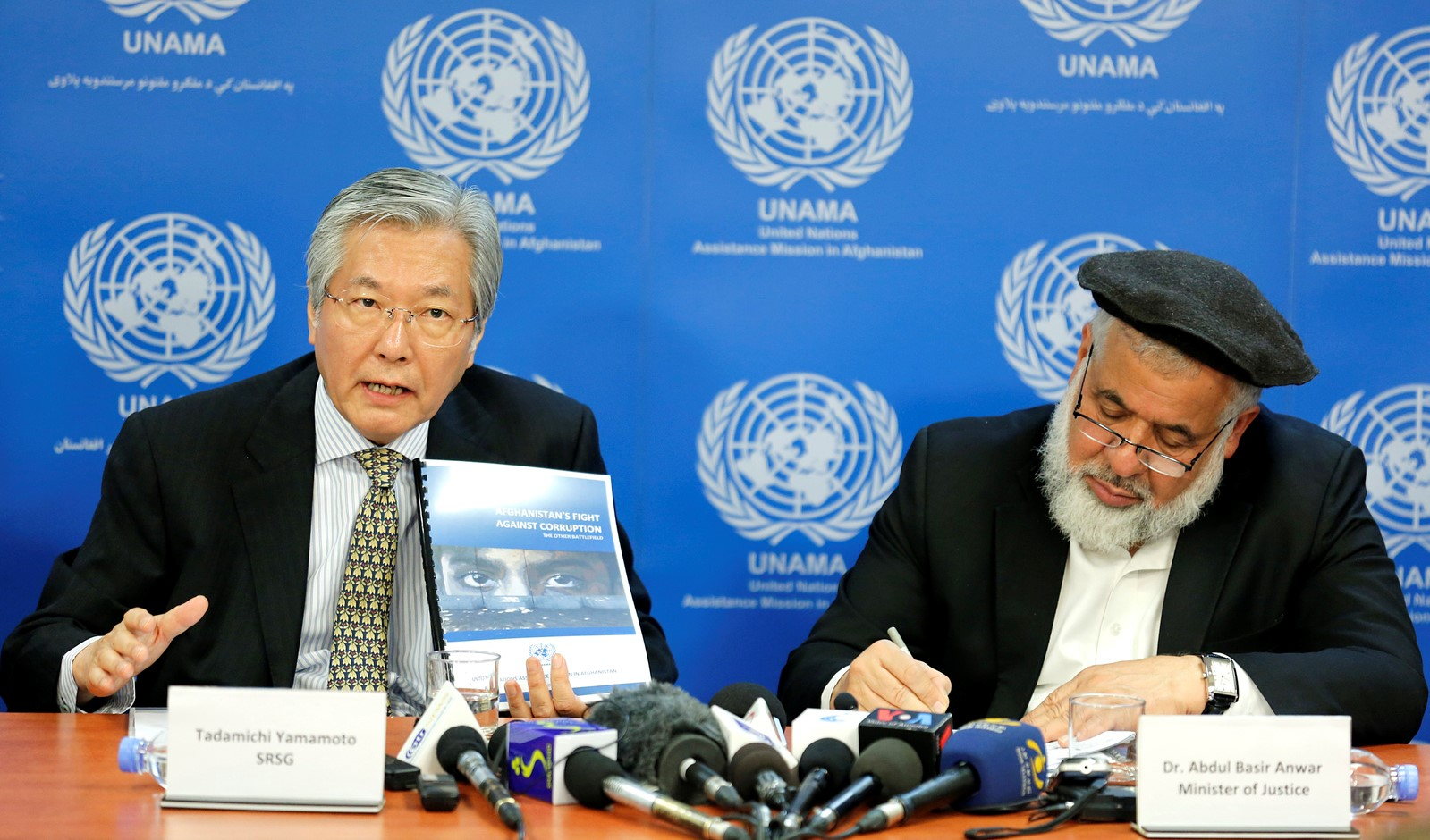 "SRSG Yamamoto in Afghanistan addresses at a press conference the launch of a UNAMA report entitled ""Afghanistan's Fight Against Corruption: The Other Battlefield"". By UN Photo/ Fardin Waezi"